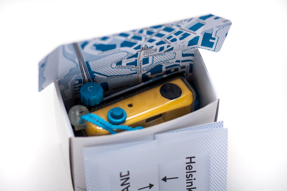 Package Design Wanderlust Folding Box For Camera With City Map Of Helsinki Inside, With Camera In Box