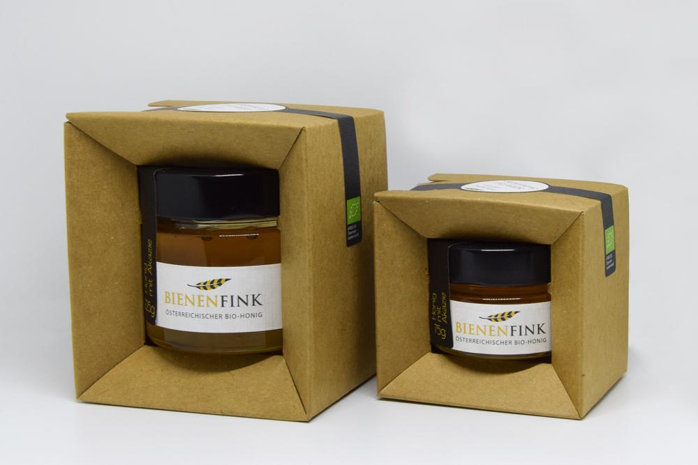 Two Honey Jars With Cardboard Packaging
