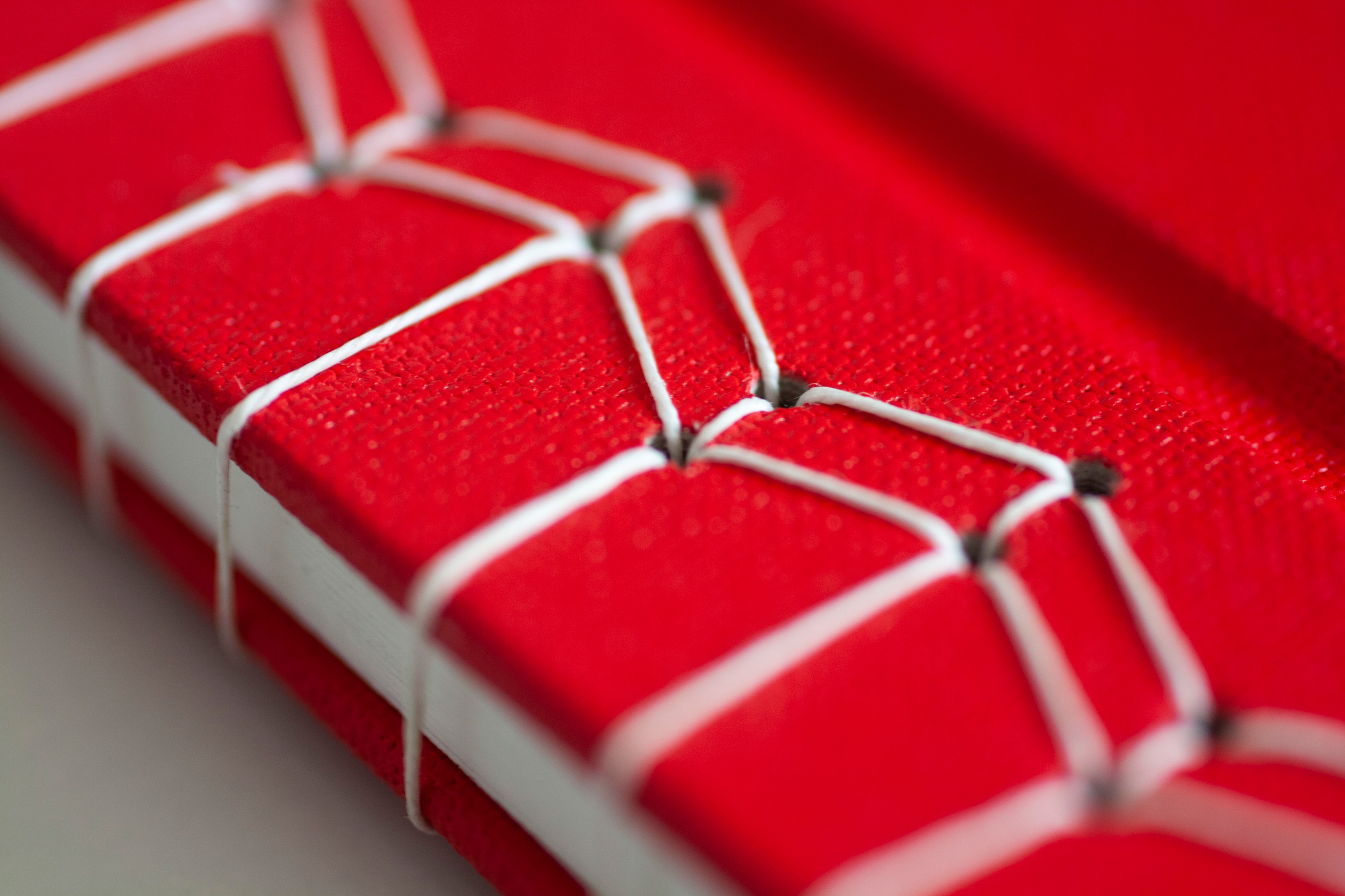 Red Book With White Japanese Stab Stitch Binding, Macro Of The Binding