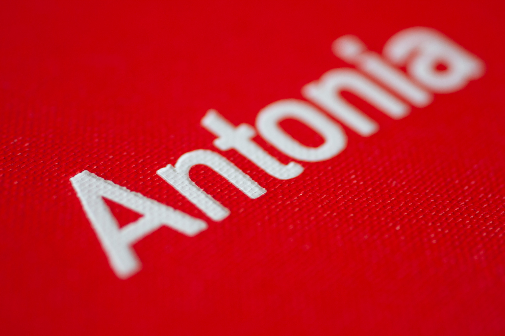"""Red Book With White Hotfoil Print """"Antonia"""", Closeup At The Name Print"""