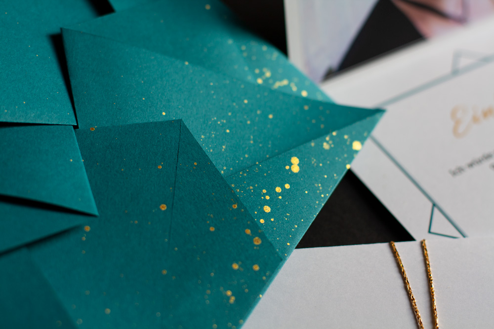 Detail Of The Blue-green Origami Envelope With Gold Splashes