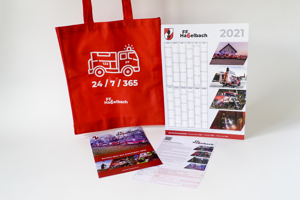 Picture Of A Red Fabric Bag With A Fire Truck And The Logo Of The Local Firefigthers, A3 Yearly Calendar, A4 Brochure With Annual Overview And A4 Info Sheet With Donation Payment Slip