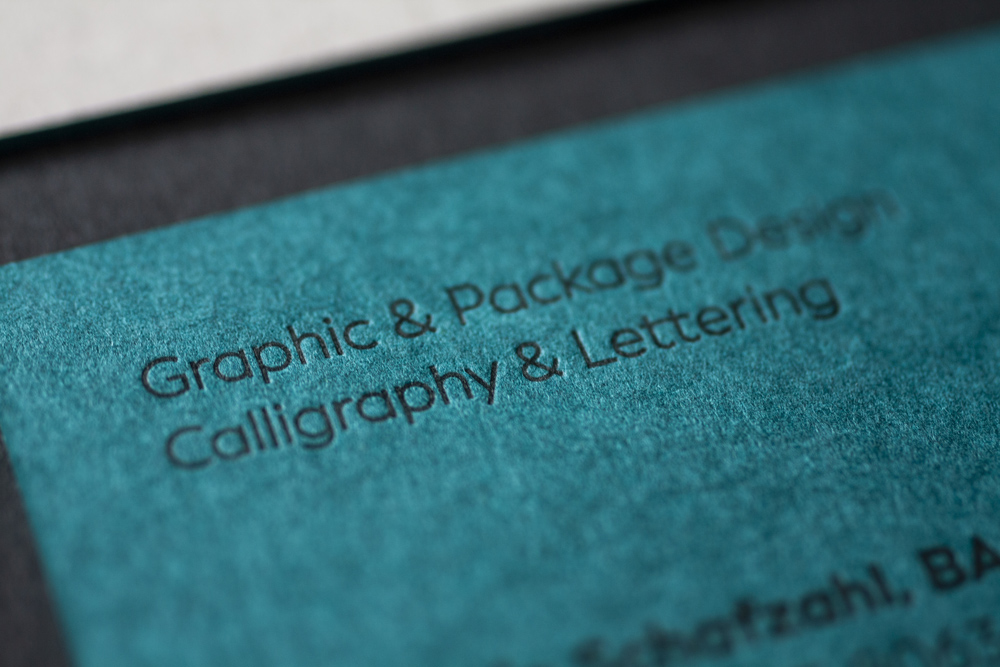 """Corporate Design And Branding For Corliss Design, Here The Business Cards Back Side With A Close Up To """"graphic & Package Design, Calligraphy & Lettering"""" Which Stands At The Top Left Corner"""